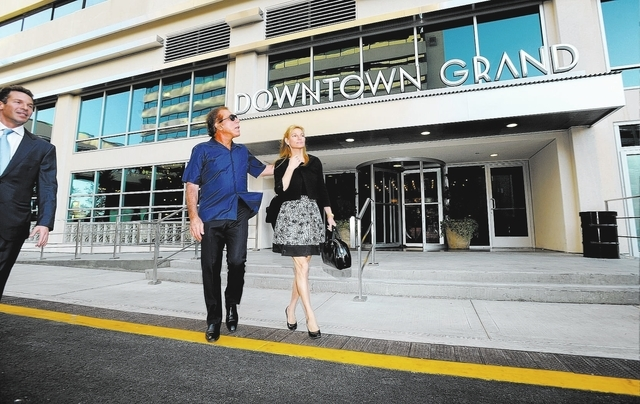 Seth Schorr, left, CEO of the Downtown Grand Las Vegas  gives Steve and Andrea Wynn, a tour of the now open  hotel and casino on Sunday, Oct. 27, 2013.  Steve Wynn was invited to make the first be ...