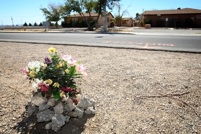 Flowers are placed  in August near the scene where a man was found dead inside a dumpster on Ringe Lane near the intersection of Nellis Boulevard and Owens Avenue. (LAS VEGAS REVIEW-JOURNAL)