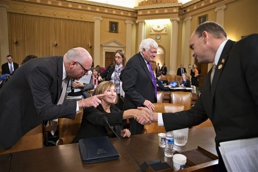 Marilyn Tavenner, the administrator of the Centers for Medicare and Medicaid Services, seated, is greeted by House Ways and Means Committee members, from left, Rep. Joseph Crowley, D-N.Y., left, a ...