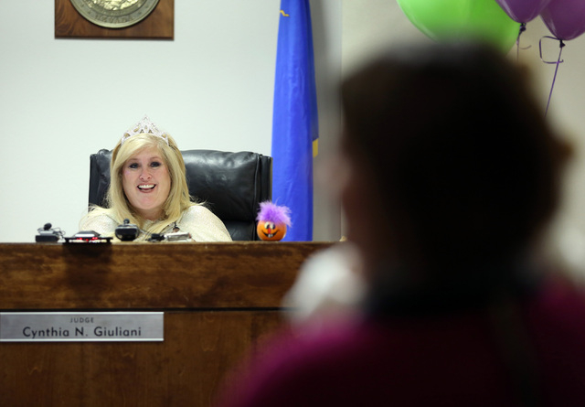 District Court Family Judge Cynthia Giuliani presides over an adoption hearing at Family Court Thursday, Oct. 31, 2013, in Las Vegas. Judge Cynthia Giuliani, who was dressed as a fairy godmother,  ...