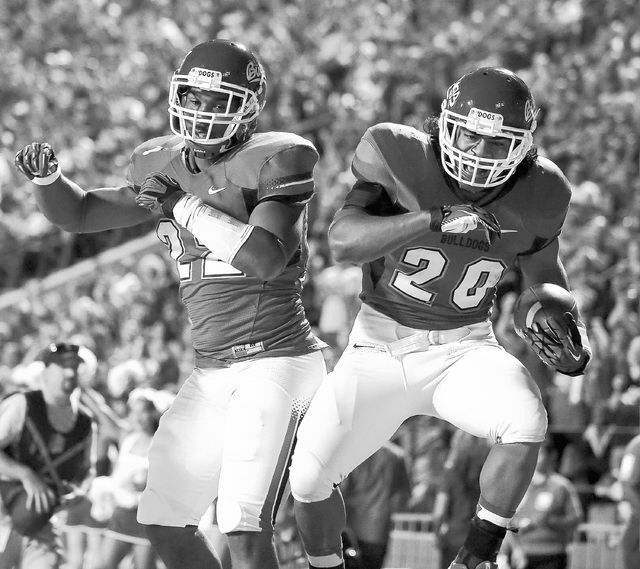 Fresno State's Malique Micenheimer (22 and Josh Quezada (20) celebrate a touchdown during the first half of an NCAA college football game Saturday, Oct. 19, 2013, in Fresno, Calif. (AP Photo/Gary  ...