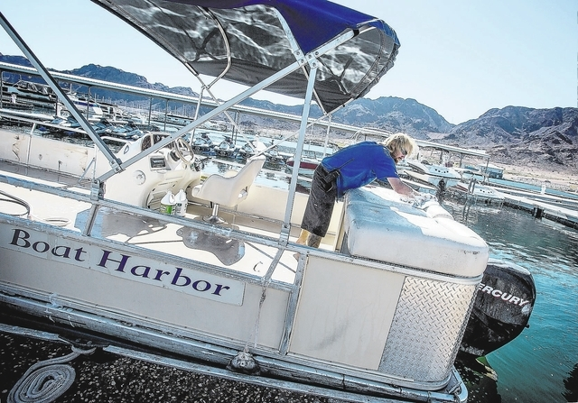James Chowning , rental associate at Las Vegas Boat Harbor, cleans a rental barge at Las Mead Marina inside Lake Mead National Recreation Area on Tuesday, Oct. 1, 2013. The company would usually b ...