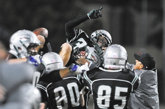 Green Valley's Conor Perkins (33) is lifted up by his teammates after making a game-winning field goal during a football game against Las Vegas at Green Valley High School in Henderson, Nev. Frida ...
