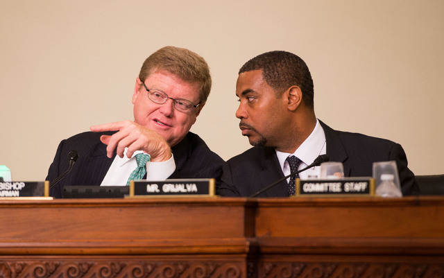 Nevada Reps. Mark Amodei, left, and Steven Horsford confer as they lead a US House hearing Thursday Oct. 3, 2013 on legislation to designate fossil beds at Tule Springs north of Las Vegas as a nat ...