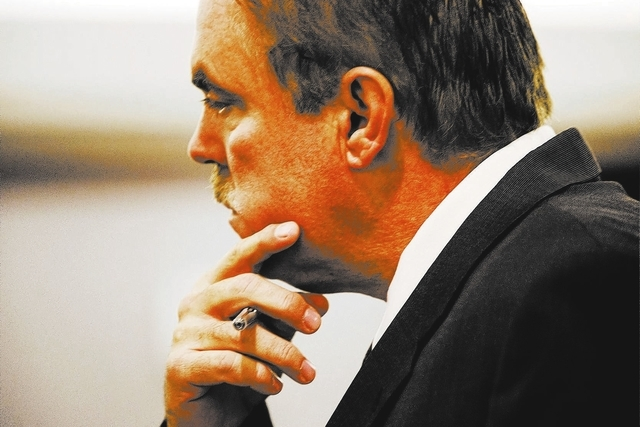 Attorney Robert Beckett,  representing his cousin Benjamin Frazier, 41,in Clark County Justice Court, Wednesday, Oct. 23, 2013.   Frazier, who is accused of killing a  casino patron and two securi ...
