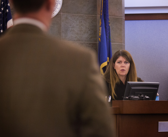 Las Vegas Justice of the Peace Cynthia Cruz, right, speaks to Chief Deputy District Attorney Brad Turner during the first appearance of defendant Benjamin Frazier in the Regional Justice Center on ...