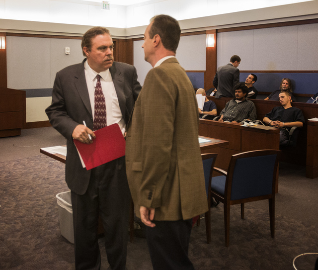 Attorney Robert Beckett, left, representing Benjamin Frazier, a family member, talks with Chief Deputy District Attorney Brad Turner in Las Vegas Justice Court on Wednesday. Frazier is accused of  ...