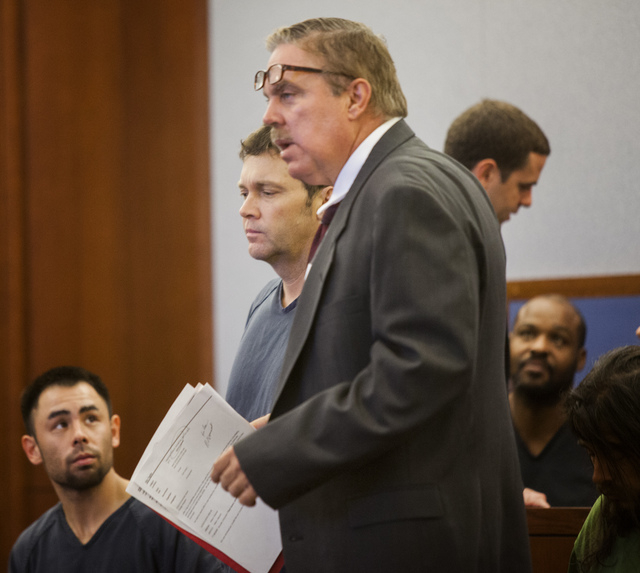 Accused nightclub shooter Ben Frazier, left, appears in Clark County Justice Court with his attorney, Robert Beckett, on Wednesday, Oct. 29, 2013. Frazier is accused of kiilling one person and wou ...