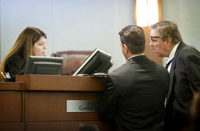 Las Vegas Justice Court Judge Cynthia Cruz, left, speaks to Chief Deputy District Attorney Robert Daskas and defense attorney Robert Beckett, right, during the first appearance of accused nightclu ...