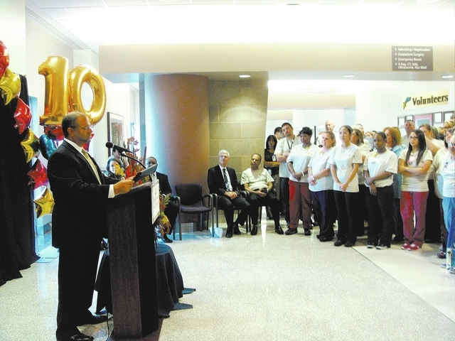 Leonard Freehof, CEO of Spring Valley Hospital, presents a certificate from Sen. Harry Reid at a staff celebration in the hospital's lobby, 5400 S. Rainbow Blvd., in Las Vegas, on Oct. 2, 2013. Th ...