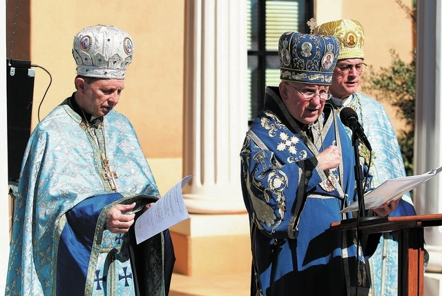 Bishop Gerald Dino of the Byzantine Catholic Eparchy of Phoenix, right, leads a prayer during a ceremony marking the one year anniversary of the St. Gabriel Catholic School at 2170 E. Maule Avenue ...
