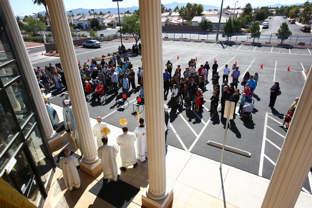People crowd around during a ceremony marking the one year anniversary of the St. Gabriel Catholic School at 2170 E. Maule Avenue in Las Vegas on Sunday, Oct. 20, 2013. (Chase Stevens/Las Vegas Re ...