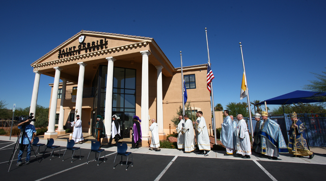 Priests and officials of the Byzantine Catholic Eparchy of Phoenix walk to begin a ceremony marking the one year anniversary of the St. Gabriel Catholic School at 2170 E. Maule Avenue in Las Vegas ...