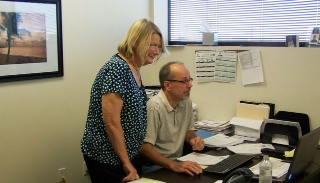 Gina De Miranda, compliance administrator at Austin HR LLC, and Dave Oyer, CFO, work on a project at the firm where De Miranda persuaded the somewhat reluctant employer to hire her. (Special to th ...