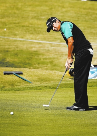 Andres Romero putts on the 10th green on Thursday, the first day of the Shriners Hospitals for Children PGA Open at TPC Summerlin. Romero finished the day at 10 under par. (John Locher/Las Vegas R ...