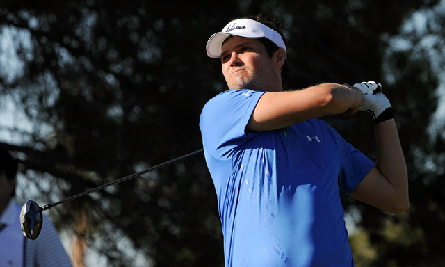 Jeff Overton watches his tee shot on the first hole during the third round of the Shriner Hospital for Children Open at the TPC Summerlin on Saturday, Oct. 19, 2013. (David Becker/Las Vegas Review ...