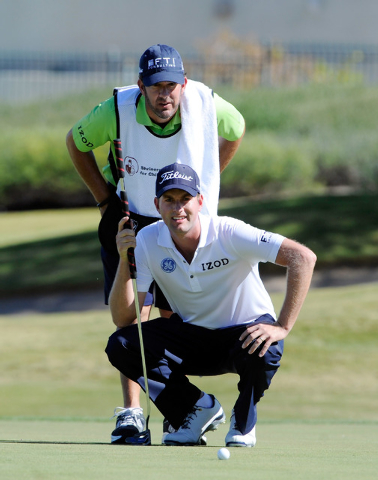 Webb Simpson looks over his putt with his caddie Paul Tesori during the third round of the Shriner Hospital for Children Open at the TPC Summerlin on Saturday, Oct. 19, 2013. (David Becker/Las Veg ...