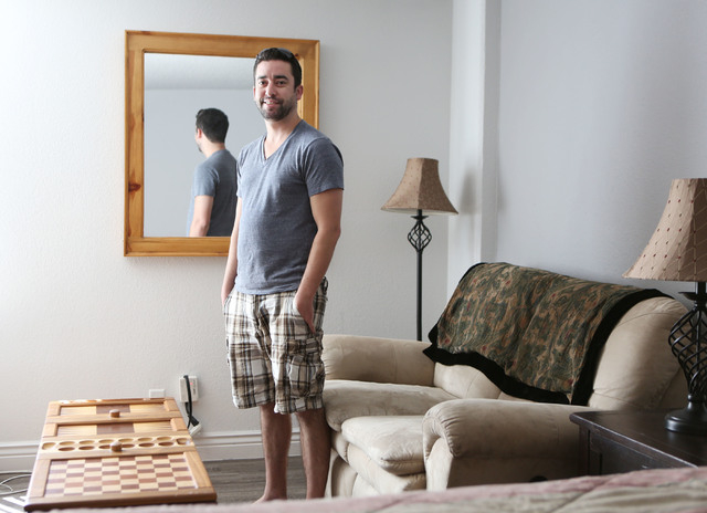 Jake McCrea stands in his studio apartment at the Gold Spike Saturday, Sept. 14, 2013, in Las Vegas. McCrea is one of the first Zappos' employees to move into the newly-transformed Gold Spike near ...