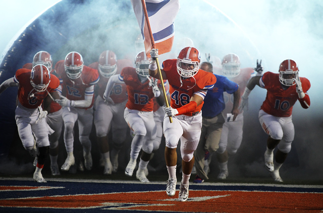 The Bishop Gorman football team, led by senior linebacker Chris Lalli (48), takes the field against Crespi (Calif.) at Fertitta Field in Las Vegas on Sept. 13, 2013. (Jason Bean/Las Vegas Review-J ...