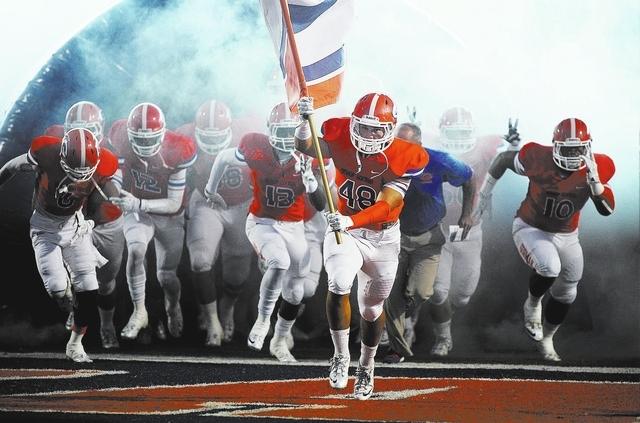 The Bishop Gorman football team, led by senior linebacker Chris Lalli (48), takes the field against Crespi (Calif.) at Fertitta Field in Las Vegas on Sept. 13, 2013. (Jason Bean/Las Vegas Review-J ...