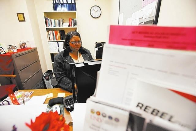 UNLV English department administrative assistant Lea Williams works in her office in the Flora Dungan Humanities building on Thursday, Oct. 10, 2013. Williams is also pursuing a masters degree in  ...