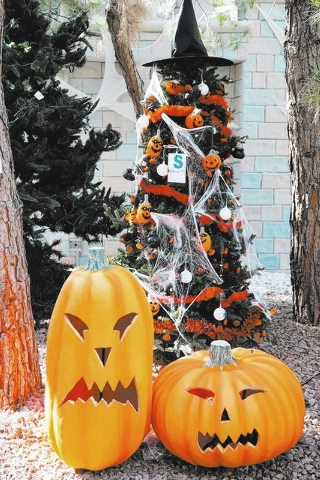 A Christmas tree decorated for Halloween is seen at Opportunity Village's Magical Forest in Las Vegas, Nev. on Oct. 3, 2013. Opportunity Village has decorated their Magical Forest for Halloween an ...