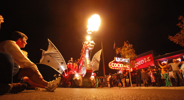 A dragon-themed Halloween parade float makes its way down Fremont Street during the Las Vegas Halloween Parade near downtown Las Vegas on Thursday, Oct. 31, 2013. (Chase Stevens/Las Vegas Review-J ...