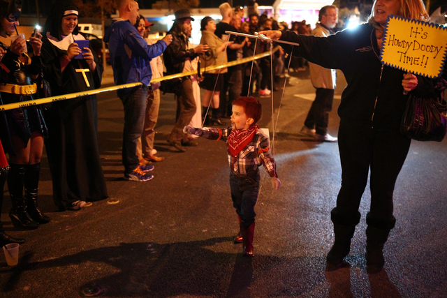 Three-year-old Jaden Brittell as Howdy Doody with mother Shelly make their way down Fremont Street during the Las Vegas Halloween Parade near downtown Las Vegas on Thursday, Oct. 31, 2013. (Chase  ...
