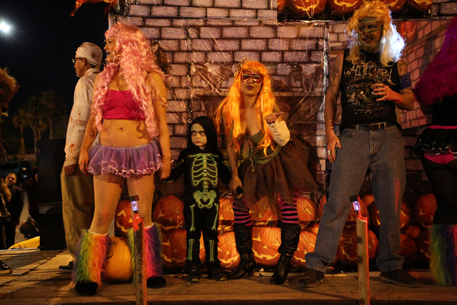 Costumed participants on a float make their way down Fremont Street during the Las Vegas Halloween Parade near downtown Las Vegas on Thursday, Oct. 31, 2013. (Chase Stevens/Las Vegas Review-Journal)