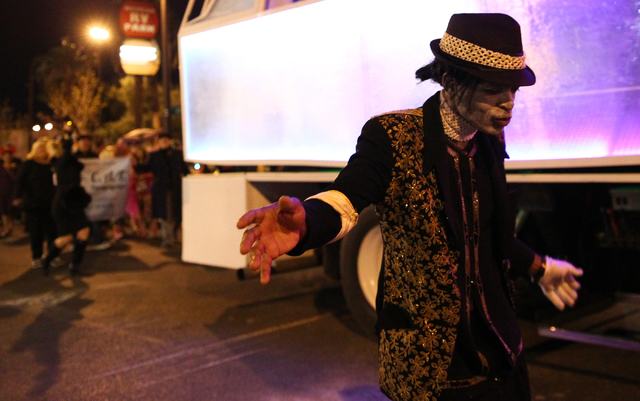 A zombie Michael Jackson makes their way down Fremont Street during the Las Vegas Halloween Parade near downtown Las Vegas on Thursday, Oct. 31, 2013. (Chase Stevens/Las Vegas Review-Journal)