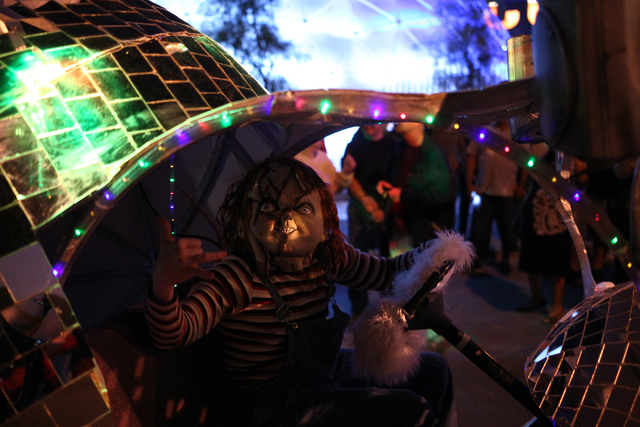 A participant dressed as Chucky drives down Fremont Street during the Las Vegas Halloween Parade near downtown Las Vegas on Thursday, Oct. 31, 2013. (Chase Stevens/Las Vegas Review-Journal)