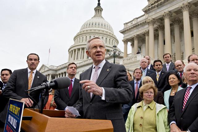 Senate Majority Leader Harry Reid, D-Nev., center, and Senate Democrats gather outside the Capitol on Oct. 9. (AP Photo/J. Scott Applewhite)