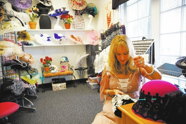 Louisa Voisine works at the Louisa Voisine Millinery, 3087 E. Warm Springs Road, Suite 7. (Chase Stevens/View)