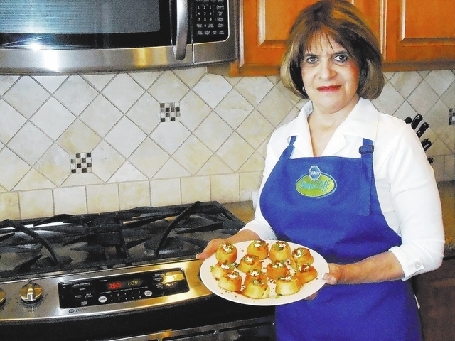 Glori Spriggs finishes practicing her recipe for the upcoming Pillsbury Bake-Off. Spriggs is set to compete in the finals in November. She plans to make her appetizer, loaded potato pinwheels, for ...
