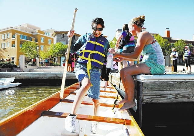 Annabelle Weislocher gets on the dragon boat for a Pink Paddlers team practice at Lake Las Vegas on Sept. 22. The team, made up of breast cancer survivors, plans to compete in St. Rose Dominican H ...