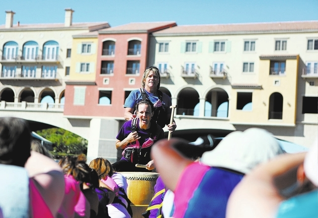 Thalia Delia, center, yells a count as Terry Maurer, center top, coaches during a Pink Paddlers team practice at Lake Las Vegas on Sept. 22. The team, made up of breast cancer survivors, plans to  ...