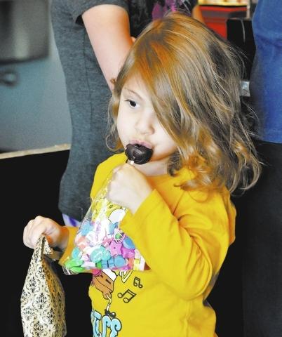 Mandy Shapiro eats a complimentary cake pop at the Showboy BakeShop, 2591 Anthem Village Drive. (Bill Hughes/View)