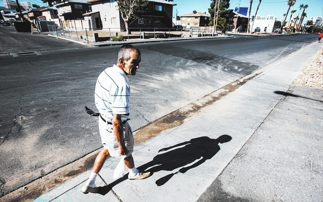 Stewart Meyer walks outside of Freedom House Sober Living, 3852 Palos Verde St., where he lived while participating in Henderson's Assistance in Breaking the Cycle court. He now lives nearby. (Cha ...