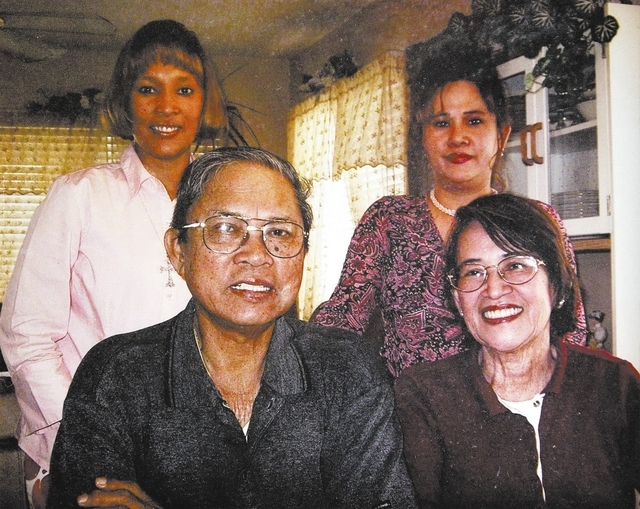 RJ FILE*** K.M. CANNON/REVIEW-JOURNAL Rodolfo Meana, 73, left, sits with his wife Linda, right, and daughters, back row from left, Marjorie and Marlene, shown in this courtesy family photograph. H ...