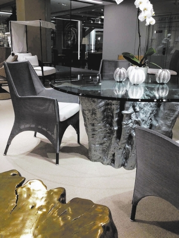 Century Leisure gives its nature-inspired table bases a contemporary spin with a metallic finish and pairing it with chairs from its elements collection. A teak tree stump served as model for the  ...