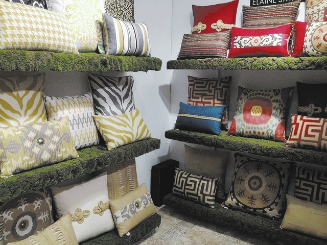 """Elaine Smith offers a variety of pillows suitable for outdoor use. The fashion-forward pieces bring in various elements of color and and pattern. """"From Runway to Poolside"""" is her motto."""