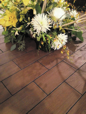 Ceramic tiles were made to resemble wood planks for this tabletop.