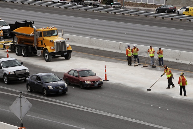 NDOT employees work to clean up a spill on north bound I-15 just south of the spaghetti bowl in Las Vegas on Sept. 10, 2013. (Jason Bean/Las Vegas Review-Journal)