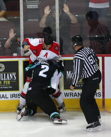 Las Vegas Wranglers' Adam Huxley fights Alaska Aces' B.J. Crum during a game at the Orleans Arena in Las Vegas on Friday, Oct. 25, 2013. (Chase Stevens/Las Vegas Review-Journal)
