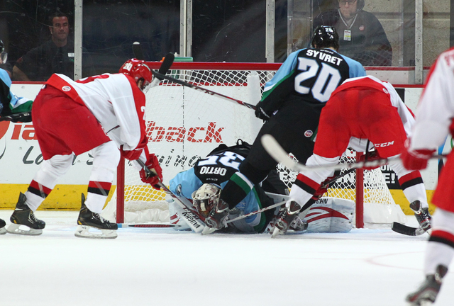 Las Vegas Wranglers players try to score against Alaska Aces during a game at the Orleans Arena in Las Vegas on Friday, Oct. 25, 2013. (Chase Stevens/Las Vegas Review-Journal)