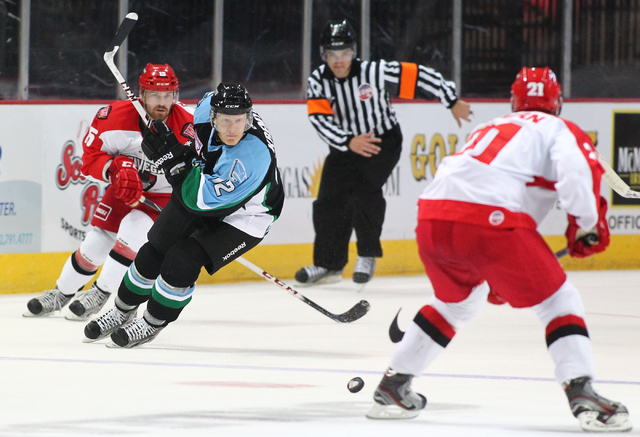 Alaska Aces' Jordan Kremyr, center, looks to take control of the puck from the Las Vegas Wranglers during a game at the Orleans Arena in Las Vegas on Friday, Oct. 25, 2013. (Chase Stevens/Las Vega ...