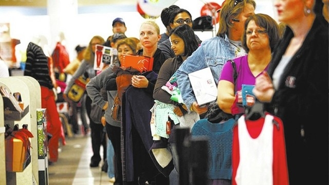 Shoppers wait in line to buy merchandise at JC Penney, 4485 S. Grand Canyon Dr., on Black Friday, Nov. 23, 2012. Retail officials estimate nearly 6,500 people will be hired this holiday season. (J ...