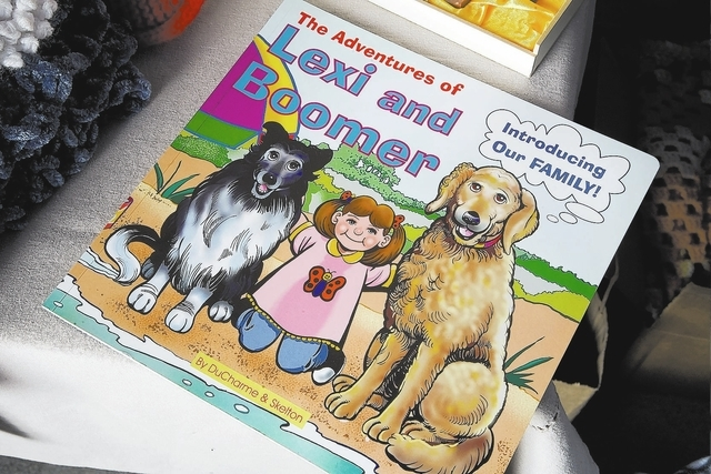The Adventures of Lexi and Boomer is a book written by a mother whoճ child attends Our Lady of Las Vegas Church in Las Vegas is displayed on Friday, Sept. 27, 2013. This and other items will ...