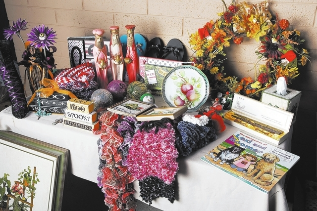 Items to be auctioned at Our Lady of Las Vegas Church in Las Vegas are displayed on Friday, Sept. 27, 2013. These and other items will be auctioned at the churchճ annual fall festival. (Jefe ...