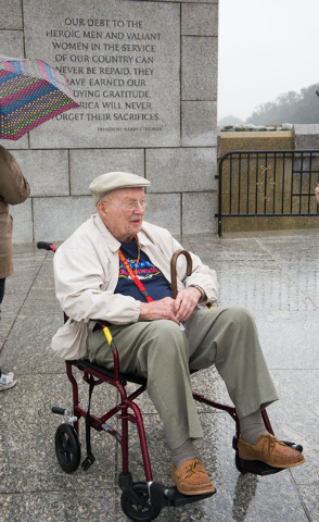 World War II Veteran Edward Murphy from Las Vegas, Nevada stops for a photograph at the World War II Memorial Saturday October 12, 2013 in Washington, DC. (Lisa Helfert/Special to the Las Vegas Re ...